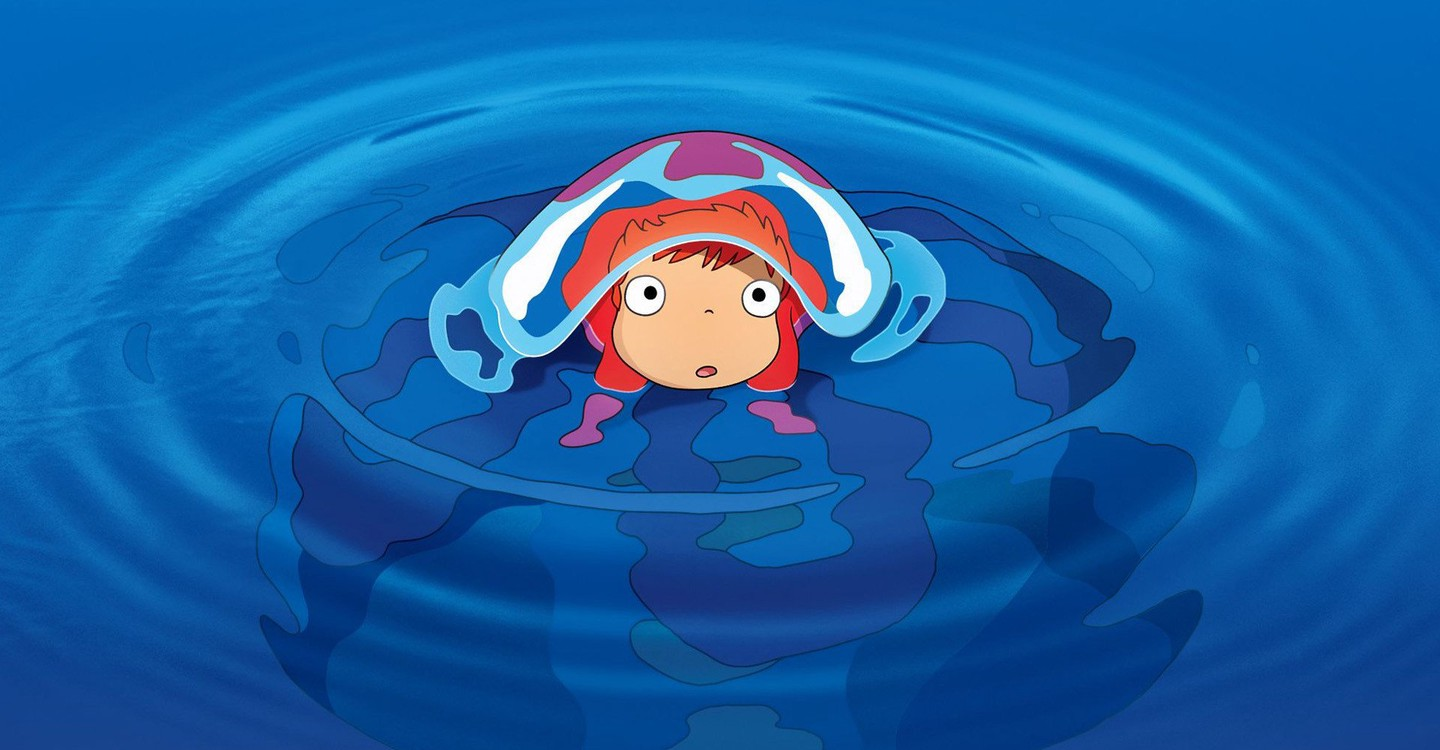 A still from the animated film Ponyo. A childlike face looks up from beneath what seems to be a wave, in a pool of blue water